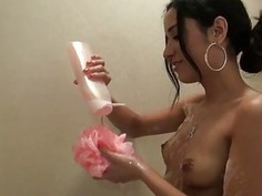 Horny latina washing her shaved pussy in the shower