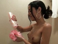 Horny latina washing her shaved cunt in the shower