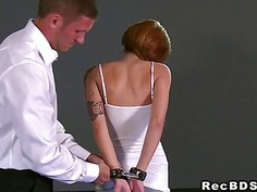 Bound redhead gets throat banged till facial