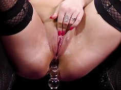 Blonde cutie plays with a nice glass dildo