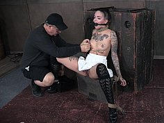 Gagged brunette with tats fucked with toys