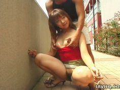 Horny babe Eri Yamaguchi wants to get fingered in the public place