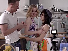Hot girls share cock in the kitchen