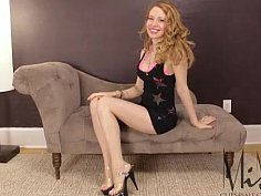Blonde MILF showing off her long legs