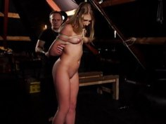 Bondage slave in sensual BDSM fetish sex with span