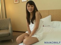 Petite milf Aoi Katayama with cute smile teases and kisses man's nipples