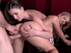 Molly Jane and her stepmom Cherie DeVille get fucked at a porno theatre