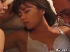 Slaty Japanese bitch Hitomi Akiyama gets stroked by kinky fuckers in threesome sex orgy