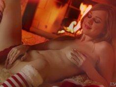 Alaina Fox pleases herself near fireplace