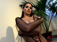 Long haired brunette in fishnet stuff uses egg vibrator for gaining delight