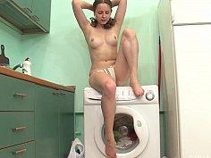 Hairy teen masturbating on a washing machine